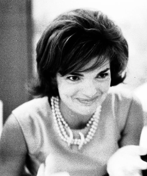 Jacqueline Kennedy. Love this picture -- she looks so full of mischief.