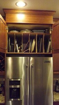 Above Refrigerator Cabinet deep enough to store pans etc and keep crap off the top of the fridge.