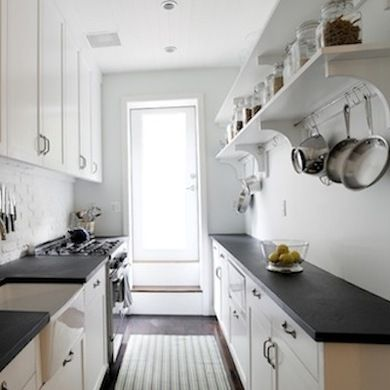 Open shelf and pot rack on one side. Is this more or less effective storage than if there were cabinets there?