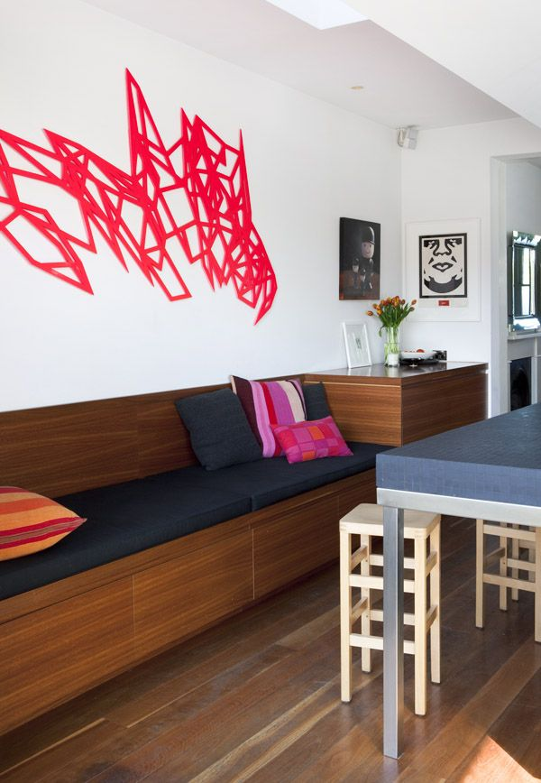dion horstman in a modern kitchen with wood banquette