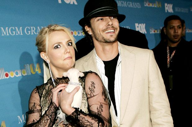 Britney Spears and then-husband Kevin Federline were mean-mugging with their dog on the red carpet at 2004's awards. | 60 Memorable Moments From Past Billboard Music Awards