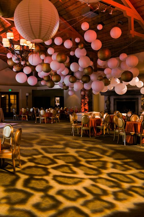 Leopard lighting, paper lanterns galore, orange, gold {So Eventful wedding & events}