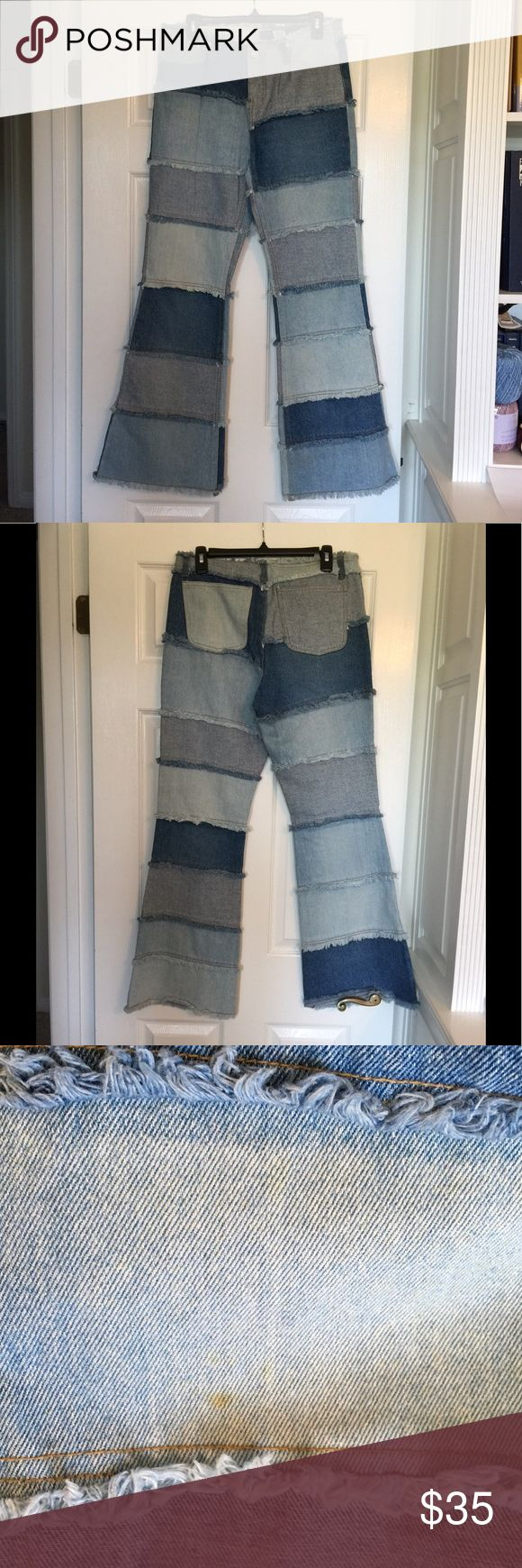 "Peppe Peluso Denim Jeans ~ Size 9 ~ New Sample Peppe Peluso Denim Jeans ~ Size 9 ~ New Sample ~ Patchwork and Frayed Denim ~ Approximate Measurements Lying Flat: Waist 15"" Inseam 32"" ~  PLEASE NOTE: ONE SMALL SPOT ON FRONT LEFT LEG PICTURED Peppe Peluso Jeans Flare & Wide Leg"