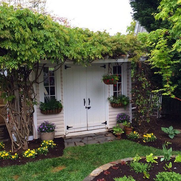 OK, we may want to live in this plant-covered She Shed full time.                   Image Source: Instagram...