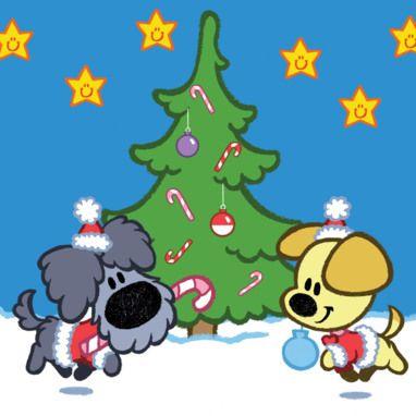 Woezel en Pip om de kerstboom in kerstoutfits.