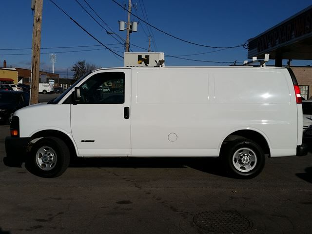 2006 Chevrolet Express 1500 Cargo Van. Front bucket seats with console steel storage box, single set of steel shelving units in cargo, hinged swing-out right-side rear/cargo doors, power steering, solar-ray tinted glass on all windows, intermittent wipers, fold-away manual mirrors and more. Call Shawn at Hughes Motor Products 416-252-1100.