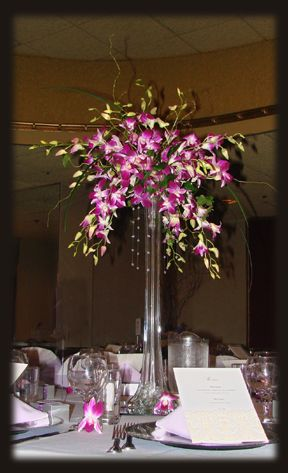 Orchids in Eiffel tower vase centerpiece