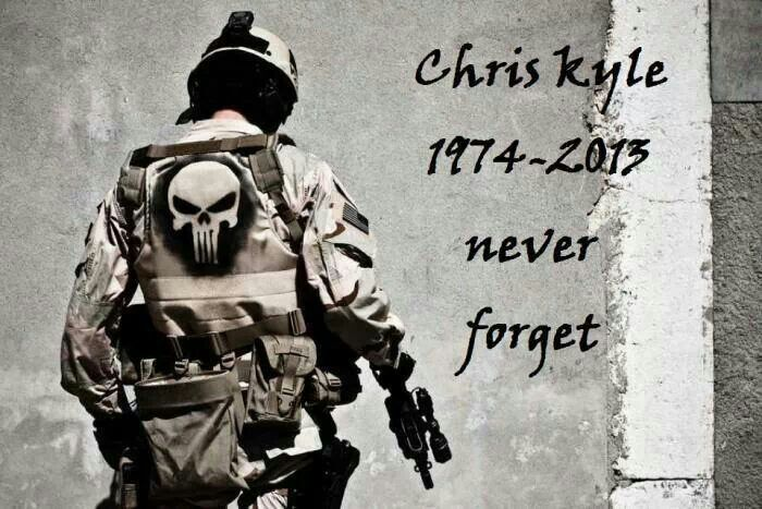 The symbol on the back of his shirt was a symbol that they made up for his team. It makes all the afghanis aware that Chris Kyle was there and ready for action