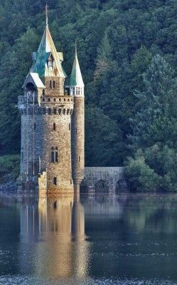Straining Tower  - Lake Vyrnwy, Wales (built in the 1880s).  Lake Vyrnwy supplies Liverpool with water. The water travels along a 70 mile aqueduct which starts at the Straining Tower. Stayed at the hotel here for work...so beautiful!