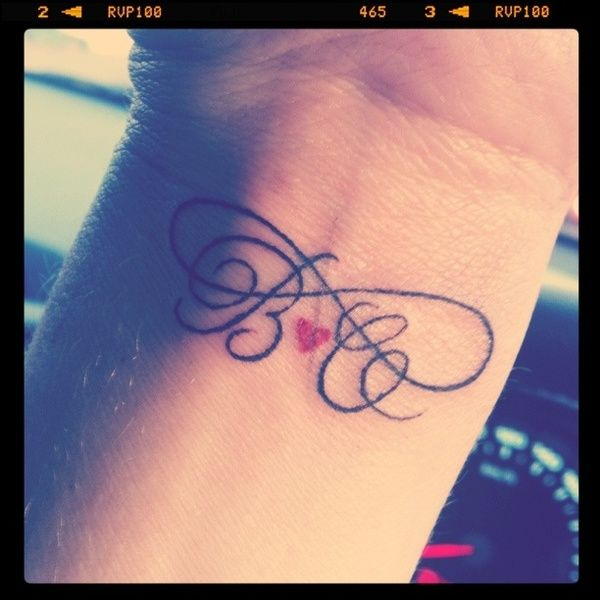 love this tattoo: his & hers initials, heart, inifinity symbol