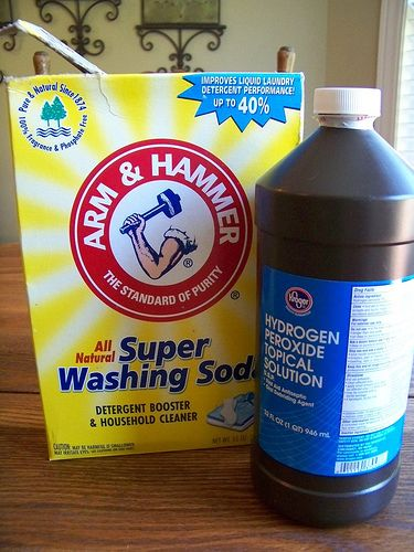 homemade oxyclean.....1 cup water, 1/2 cup hydrogen peroxide and 1/2 cup washing soda....mix and store in dark container. Can use like Shout spray or soak item in this overnight. Then wash as usual.