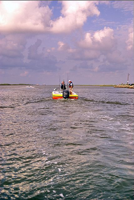"Capt. James ""Frenchie"" France of Anahuac, Texas motors his big Skeeter bay boat up the Gulf Intracoastal Waterway north of Bolivar Yacht Basin on Bolivar Peninsula. By coastalangler: Larry Bozka   This photo was taken on June 24, 2007 using a Nikon D80. #skeeterboatsfishing"