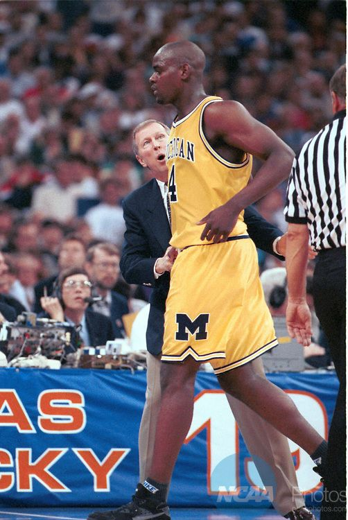 05 APR 1993:  University of Michigan head coach Steve Fisher talks with forward Chris Webber (4) after he called a time out when Michigan was out of time outs which caused a technical and lost the game during the NCAA men's Final Four basketball championship held in New Orleans, LA at the Superdome. North Carolina defeated Michigan 77-71 for title