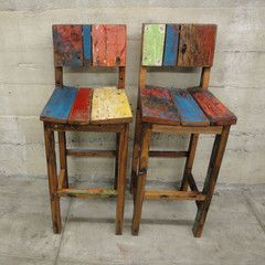 Reclaimed Teak Bar Stool, Indonesia   These barstools are made from salvaged and refinished teak. The wood used came from the brightly painted fishing boats that were destroyed during the Indian Ocean tsunami. A small industry arose in Indonesia around creative rebuilding, giving the people who make the boat furniture a means to make a living.