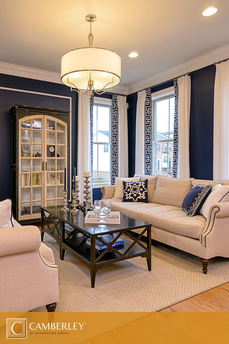 Modern nautical living room - Decorative Throw Pillows Navy Blue Paint And A Modern Chandelier In Our Sedona Model Give The Living Room A Luxurious Yet Nautical Feel