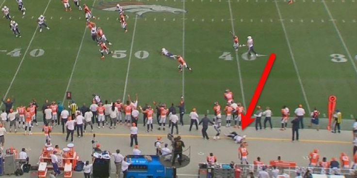 Broncos coach Wade Phillips was carted off the field after a violent collision with a Chargers player