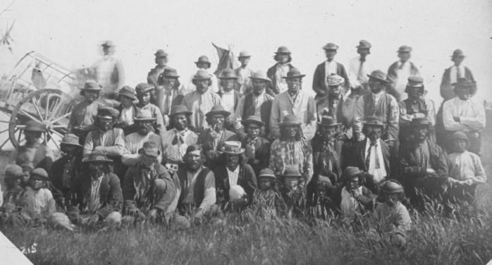 """Boundary Commission Scouts and Metis hunters from the """"Big Camp"""" July 18, 1874. Note the number of men who are wearing vests - beaded or otherwise."""