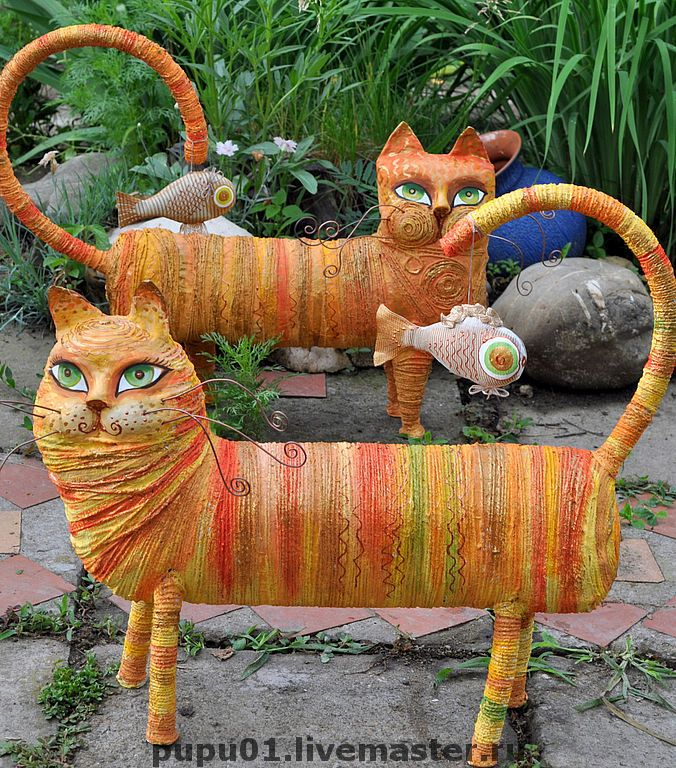 Cats by Tatiana Pushina. Paper mache, twine.