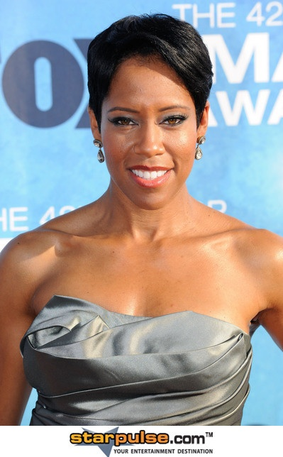 Regina King, representing the caramel skinned,-light-eyed sistas...  We are uncommonly beautiful...