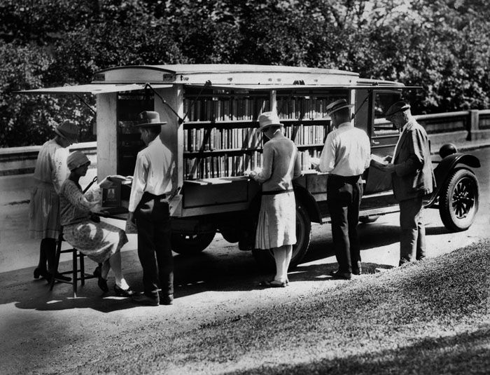 This photograph of the first bookmobile of the Public Library of Cincinnati & Hamilton County, Ohio was taken in 1927. The library began its bookmobile service to rural schools in 1927 and eventually expanded it to other areas. My guess is it is based on a Chevrolet commercial vehicle, circa 1927.
