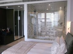glass screen between bedroom and bathroom