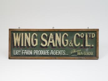 Sign, 'Wing Sang & Co Ltd', metal / wood, made by Tierney, Australia, used by Wing Sang & Co Ltd, Haymarket, New South Wales, Australia, 1935-1965.