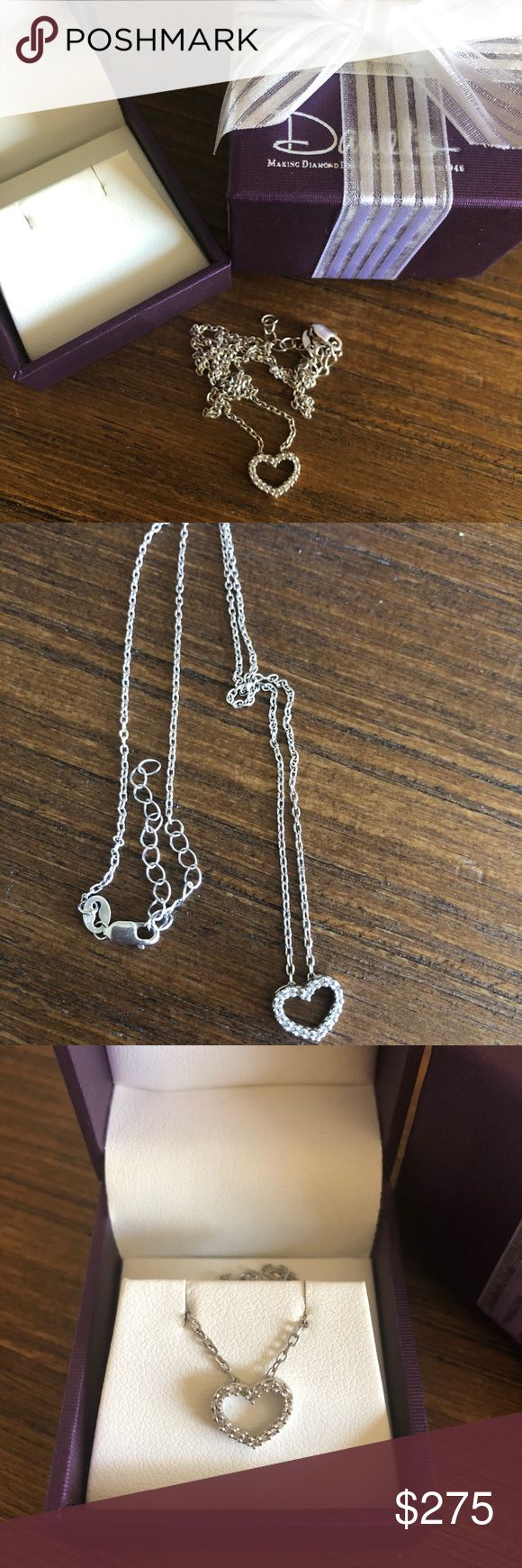 Heart Necklace 1/12CTW Diamonds & 10K White Gold Brand new Product Description Lovely 1/12CTW Diamond Heart Pendant is beautifully designed with 20 Round Diamonds set in 10K White Gold and comes with an 18 inch Rope Chain by Daniel's Jewelry  The chain has a stamp 925 And the heart has a 10K stamp Never used  It comes with the box gift box and a gift bag I got this as a gift and I don't have the price tag never used I don't have the gift receipt daniel's Jeweler Jewelry Necklaces