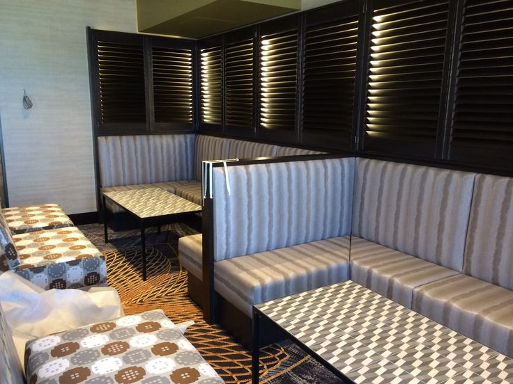Contemporary style striped booth seating bu Eurofurn.