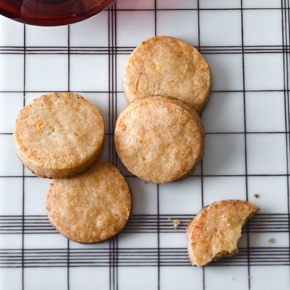 A pinch of cayenne pepper adds a spicy kick to these savory cookies, flavored with sharp cheddar and smoked Gouda cheese.