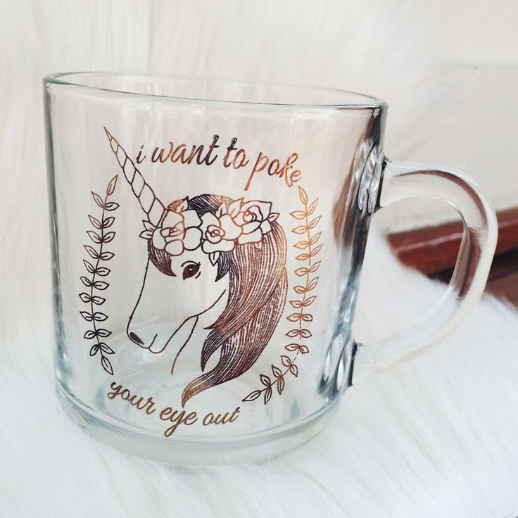 """// for those grouchy mornings when you could use a little humor. Our  Unicorn """"i want to poke your eye out mug"""" is just the thing.  10 oz glass mug // Gold Metallic design  permanent and dishwasher safe (imprints will not scratch off)  made with the highest quality eco-friendly and lead free inks // safe for  the entire family"""