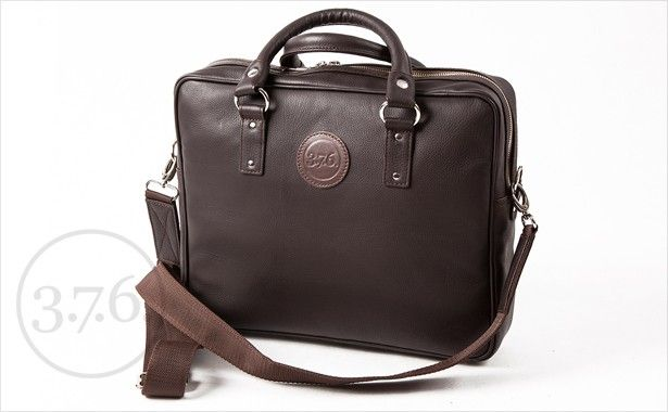 Natural leather, dark brown with brown fabric inside.  www.376west.com