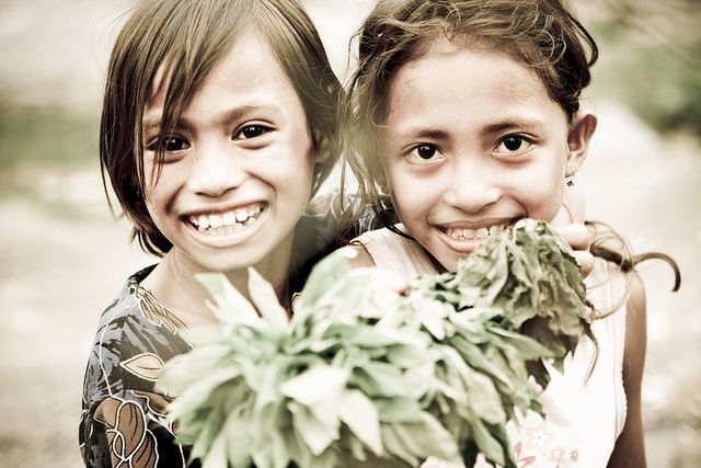 A portrait of two young girls in Timor-Leste