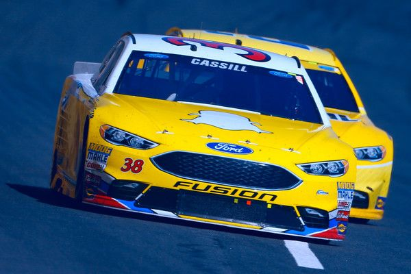 Landon Cassill, driver of the #38 Rev the Vote/Snapchat Ford, races during the NASCAR Sprint Cup Series Bank of America 500 at Charlotte Motor Speedway on October 9, 2016 in Charlotte, North Carolina.