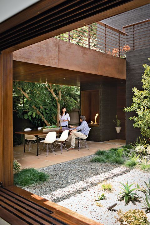 A house designed to be part of the landscape is at home among the trees in Venice, California. The residents often dine on the patio off the kitchen, warmed by a fireplace from Spark Modern Fires. Photo by Coral von Zumwalt. Courtesy of Coral von Zumwalt . This originally appeared in A Modern Bungalow in Venice Beach .