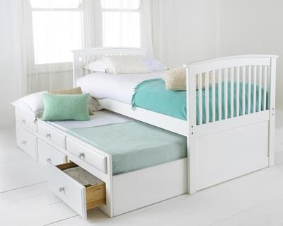 Twin trundle/captains bed. Friends have a space for sleep overs, can be tucked away to save floor space. Plus a few drawers for storage