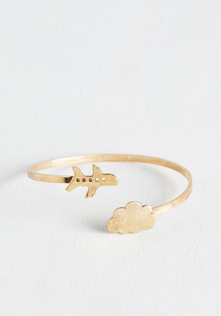 Looking Fly in the Sky Bracelet. Three, two, fun, lift off in this gold bracelet! #gold #modcloth