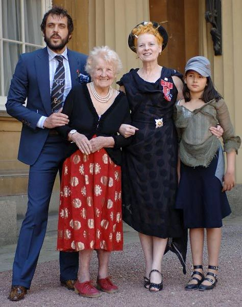 Vivienne Westwood receives her DBE honour and poses with her husband Andreas Kronthaler, her elderly mother Dora Swire, and her eight-year-old granddaughter Cora Corre. 2006