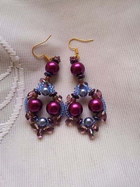 Romance chandelier earrings pearls lentils. Large cherry glass pearls, amethyst glass drops, lentils beads, royal blue glass pearls in a combination of an elegant pair of earrings. Gold plated hooks. 7 cm long aprox.