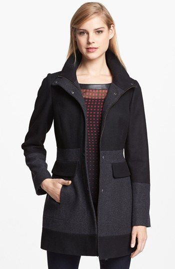 GUESS Two Tone Wool Blend Coat Contemporary color blocking and a feminine fit-and-flare silhouette redefine a warm and practical coat topped with a detachable hood. Front zip closure with outer snap placket. On-seam front pockets with nonfunctional flap. Fully lined, with shoulder pads. Wool/polyester/rayon; dry clean.