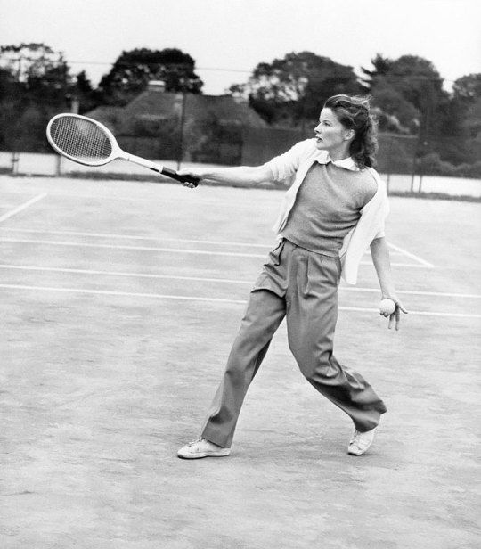 Katharine Hepburn playing tennis at the Merion Cricket Club in Haverford, Pennsylvania during the filming of The Philadelphia Story, 1949