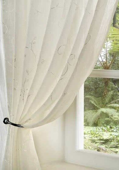 Crushed Scala Voile Panel, a Delicate Cream Voile Embroidered with a Leafy Pattern. Ready to hang with a 5cm heading for use with net rod/wire or curtain track/pole.  To create sufficient fullness, use enough panels to cover at least twice the width of the window. 100% Polyester. from £9.99