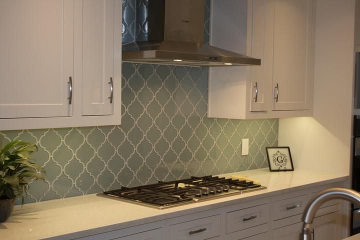 Bring a touch of elegance to your new new kitchen backsplash or bathroom with our Jasper Arabesque Glass Tiles. These tiles are stunning! The color is a blue gr