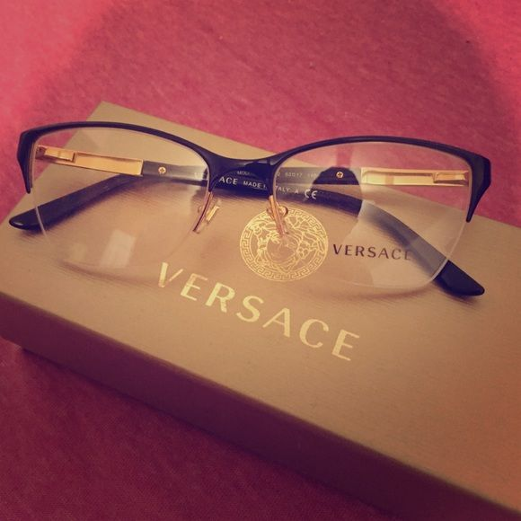 Brand new Versace glasses Brand new, never used Versace glasses black and gold, with original tags and case. Versace Accessories Glasses