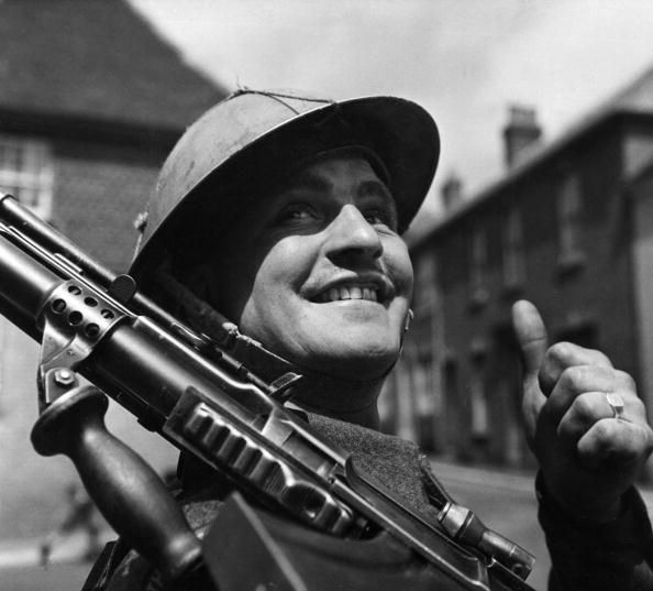 6th June 1944: A British soldier, encamped in a small English village, gives the thumbs-up as he awaits his orders for D-Day. (Photo by Fox Photos/Getty Images)