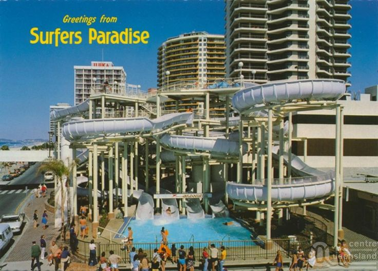 The water slide at Surfers Paradise is one of the Gold Coast's most popular tourist attractions - Postcard, circa 1970's