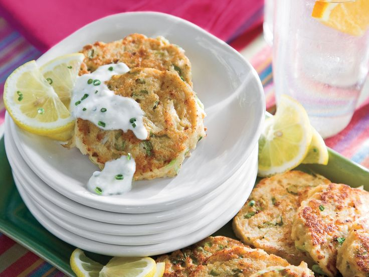Mini Crab Cakes With Garlic-Chive Sauce | Cook these mini crab cakes over medium-low heat to ensure a deep golden crust without overcooking the delicate crab. Pair with our homemade garlic-chive sauce.