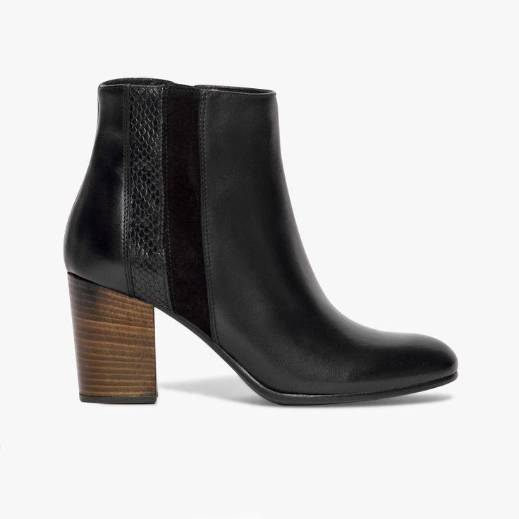 Boots noir talon haut Un boots très élégant et féminin avec ses empiècements en cuir velours et cuir imprimé animal sur les côtés. A noter, son zip sur le côté intérieur pour faciliter le chaussant. Talon : 7.5 cm. •#SHOESINMYLIFE On peut l'associer avec une jolie paire de collants et une jupe fluide. •Prendre votre pointure habituelle.