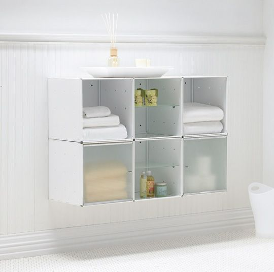 hang something just like this on top of hamper and use as medicine box as well. http://www.bathroomdesignideasx.com/wp-content/uploads/2012/04/wallmounted-bathroom-storage.jpg