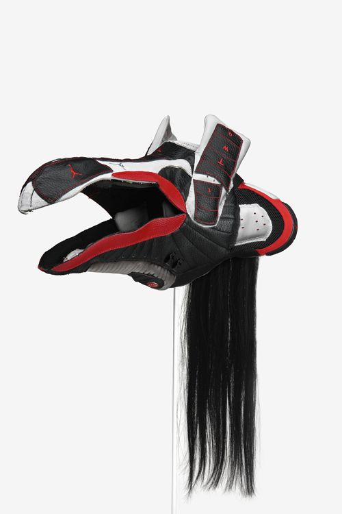 Brian Jungen, Prototype for New Understanding #16, 2004,Nike athletic footwear, human hair,Collection of Joel Wachs, New York,Photo: Trevor Mills, Vancouver Art Gallery
