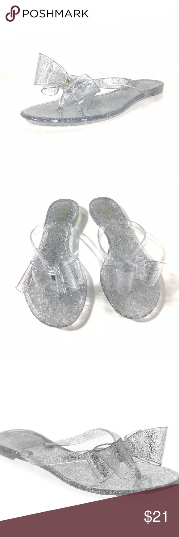 Maker's Shoes Clear Jelly Silver Flip Flops Cool and clear! These jelly flip flop sandals are a must have for the summer. Medium width and true to size. Also available in gold, please see other listing. Maker's Shoes Shoes Sandals